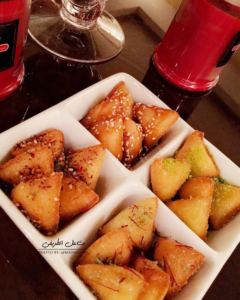 http://www.encyclopediacooking.com/food-recipes-photos/arabic-food-cooking-recipes-in-arabic-triangles-semolina-mashael-al-tarifi.jpg
