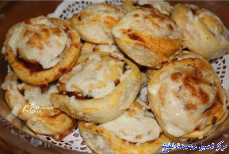 -how to make pizza step by step picturesطريقة عمل رولات البيتزا بالصور خطوة بخطوة