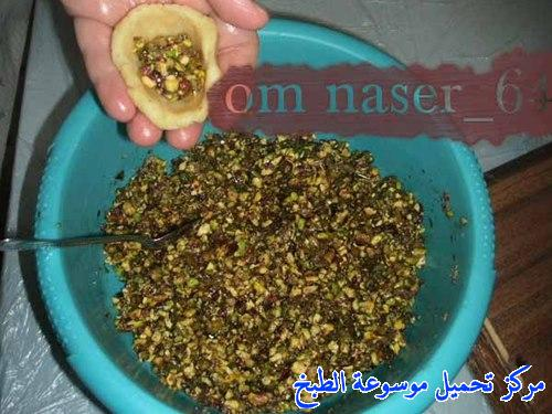 http://www.encyclopediacooking.com/upload_recipes_online/uploads/images_maamoul-recipe-in-arabic-%D9%85%D8%B9%D9%85%D9%88%D9%84-%D8%A8%D8%A7%D9%84%D8%AA%D9%85%D8%B1-%D9%88%D8%A7%D9%84%D9%81%D8%B3%D8%AA%D9%82-%D8%A7%D9%84%D8%AD%D9%84%D8%A8%D9%8A-%D9%88%D8%A7%D9%84%D8%AC%D9%88%D8%B220.jpg